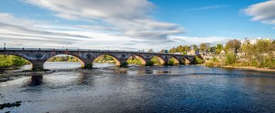 Scenic arched West Bridge across River Tay in Perth city. Scotland Royalty Free Stock Images