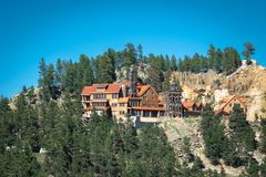 Scenic architecture and spruce trees on a hill in Keystone, South Dakota, USA. Keystone is a favorite place among tourists in the Black Hills of South Dakota stock image