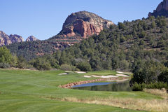 Scenic Arizona Golf Course. A cart sits in the fairway on a scenic sedona arizona golf hole with red rock backdrop Stock Photography