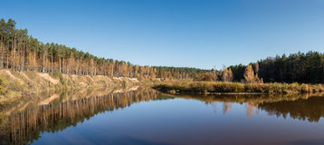 Scenic autumn colored river in country. With trees and reflections Royalty Free Stock Images