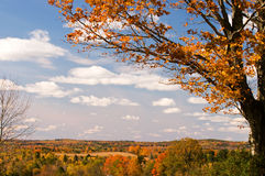 Scenic autumn foliage Maine. Scenic colorful autumn or fall leaves across the rolling hills and countryside of northern Maine Stock Image