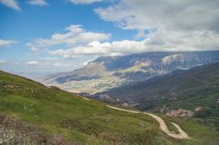 Scenic autumn landscape in the Caucasus Mountains. Empty mountain winding road. Sharp bend. Royalty Free Stock Photography