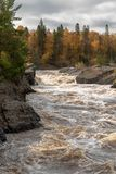 Scenic Autumn woods along the rushing rapids of the St. Louis River at Jay Cooke State Park in Northern Minnesota stock photography