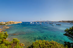 Scenic bay with turquoise water and sailing boat anchorage. Stock Photo