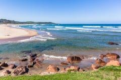 Beach Blue Ocean River Mouth Rocky Scenic Landscape stock photo