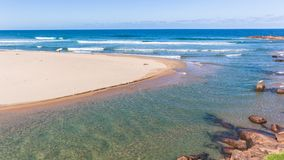 Scenic Beach Blue Ocean River Mouth Surfer Landscape royalty free stock image