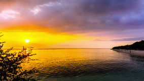 Scenic Beach Cloudscape Sunset Timelapse. It's a colorful beach landscape with a clear water and golden sunset view with cloudy sky. This timelapse was taken at stock video