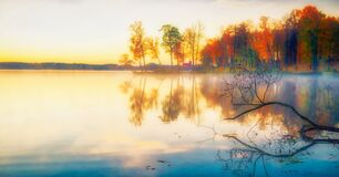 Scenic beautiful fall autumn lake landscape scenery at sundown