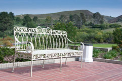 Scenic Bench. White iron bench with scenic rolling hills in the background Stock Image