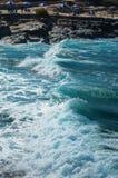 Big waves in a beach of Crete. Scenic big blue waves in a beach of Crete Royalty Free Stock Images