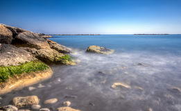 Scenic blue beach with clear sea waters at Germasogia, Limassol Royalty Free Stock Photography