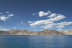 Scenic blue high mountain lake among desert hills Stock Image