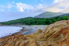 Scenic blue sky sunset landscape of stony seashore of Black Sea coast in Caucasus Mountains by Anapa, Russia royalty free stock image