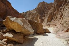 Scenic boulders in the desert canyon, Israel. Scenic boulders in the desert canyon Nachal Ogg near the Dead Sea, Israel Stock Photos