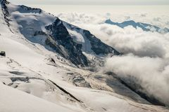 Scenic Breithorn mountain during summer time above Cervinia village in Italy. Scenic landscape around Breithorn mountain during summer season above Cervinia Stock Photos