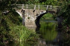 Scenic bridge. Scenic stone and wooden bridge over a river Stock Images