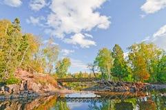 Scenic Bridge over a Quiet Stream Stock Images