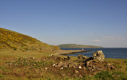Scenic Bute. View across the ruins of an old inn, Glencallum Bay, south Bute, Scotland; the  scenic coastline forms part of the  route of the  West Island Way Royalty Free Stock Image