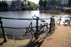 Scenic Bycicle in an Amsterdam Canal Royalty Free Stock Image
