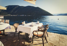 Scenic cafe table with sea view Royalty Free Stock Image