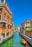 Scenic canal with boats, Venice, Italy, HDR Royalty Free Stock Images