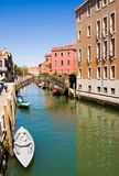 Scenic canal with boats, Venice, Italy Stock Photography