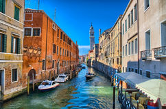 Scenic canal with Carabinieri boats, Venice, Italy Stock Images