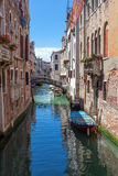 Scenic canal with colorful ancient houses, Venice, Italy Royalty Free Stock Images