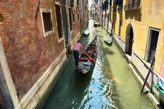 Scenic canal with gondola, gondolier, Venice, Italy. Gondolier on the way to the grand canal, venice, italy Stock Photography