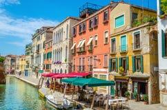 Scenic canal with italian restaurant, Venice. Italy Royalty Free Stock Image