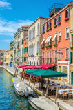 Scenic canal with italian restaurant , Venice Stock Photos
