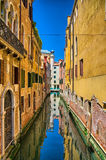 Scenic canal on sunny day, Venice, Italy Stock Photos