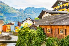 Scenic canal in Ebensee village, Alps mountains, Austria. Scenic canal with traditional austrian architecture in Ebensee village, Alps mountains, Austria Stock Photo