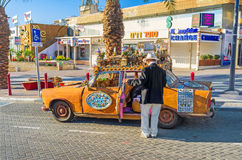 The scenic car. EILAT, ISRAEL - FEBRUARY 24, 2016: The tourist car driver waits for the clients, offering an excursion in unusual car, on February 24 in Eilat stock photo