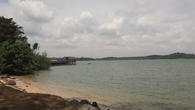 Scenic Changi Point Beach on a Cloudy Day in Singapore Panning 1080p stock video footage