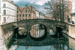Scenic city view of Bruges canal and bridge Stock Photo