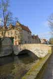 Scenic city view of Bruges canal, bridge and flemish house Royalty Free Stock Images