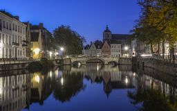Scenic city view of Bruges canal at night stock images