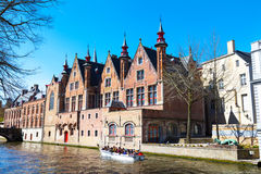 Scenic cityscape with houses, boat with tourists at Green canal, Groenerei in Bruges, Belgium Royalty Free Stock Image