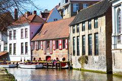 Scenic cityscape with medieval houses, boat and canal in Brugge, Belgium Stock Photo