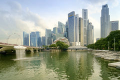 A scenic cloud fountain. Marina Bay, Singapore - November 1, 2016: A scenic cloud fountain over the Marina Bay reservoir and high rise downtown core of Singapore Royalty Free Stock Photography