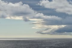 Scenic clouds over sea. Scenic white and grey clouds over sea horizon, clear seascape with picturesque sky Stock Photos