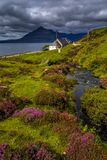 Scenic Coastal Landscape With Mountain River in Picturesque Valley With Flowers And Bridge On The Isle Of Skye In Scotland.  stock photo