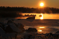 Scenic coastal winterlandscape. Scenic sunrise at the coast in wintertime Royalty Free Stock Image