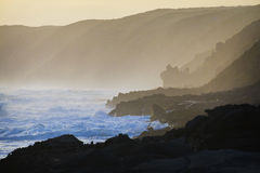 Scenic coastline. Surf and waves along a rocky coastline at twilight Royalty Free Stock Photos
