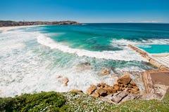 Scenic coastline with blue sky and sun Stock Photos