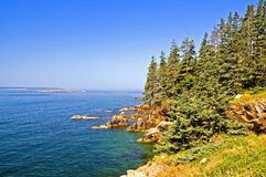 Scenic coastline of Maine. A view of the beautiful rocky coastline of Maine  with blue water and sky on Swans Island on a clear, summer day Stock Photos