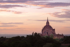Scenic colorful sunset of ancient temple in Bagan Stock Images