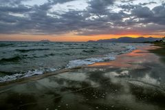 Scenic colorful sunset at the sea coast with dramatic clouds over the Mediterranean sea. royalty free stock photo