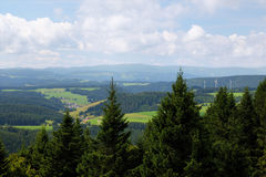 Scenic countryside landscape in the Black Forest: green summer mountain valley with forests, fields and old houses in Stock Photos